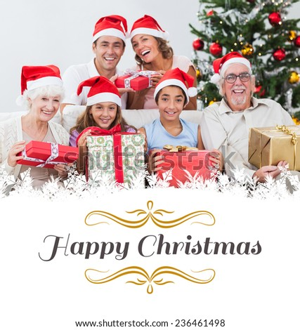 Family exchanging christmas presents against border - stock photo