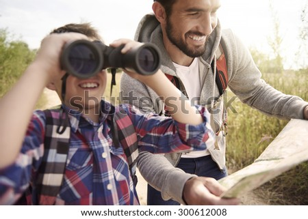 Family exploring new places on nature - stock photo
