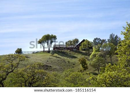 Family farm house on a green hill - stock photo