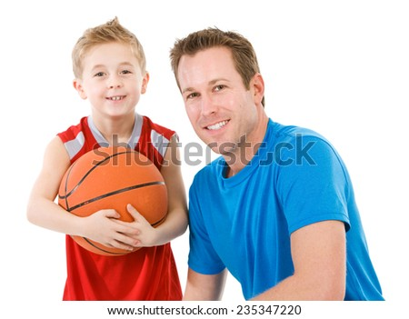 Family: Father And Son Ready To Play Basketball - stock photo