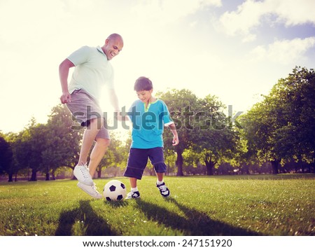 Family Father Son Playing Football Summer Concept - stock photo
