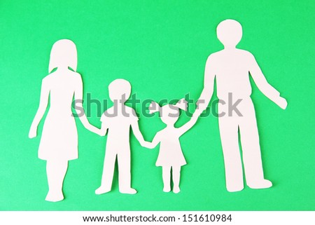 Family from paper on bright background - stock photo