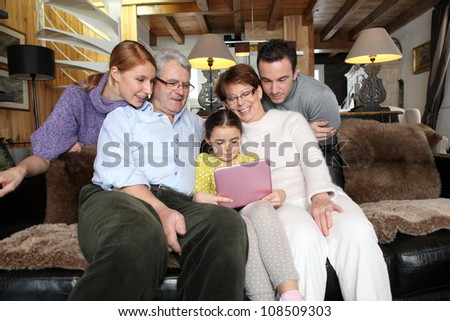 family gathering at home with laptop