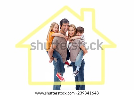 Family giving children piggyback ride against house outline