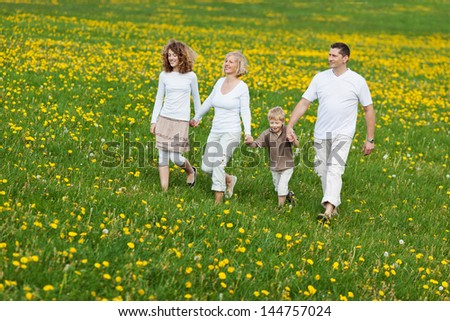 family going for a walk over green field