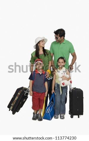 Family going for vacations and smiling - stock photo