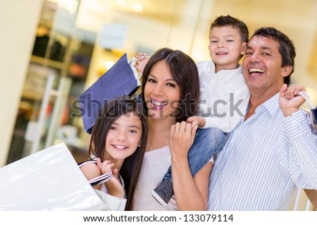 Family going shopping and looking very happy - stock photo