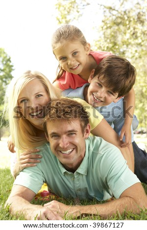 Family Group Having Fun In Park - stock photo