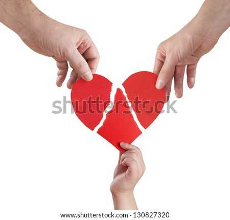 family hands connecting torn pieces of hart, clipping path included - stock photo