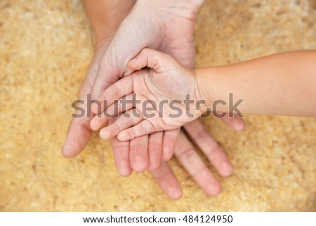 Family hands on stone background