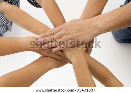 Family hands together on white background