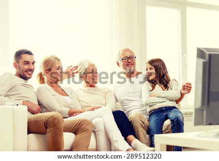 Living Room With Tv And People happy family watching tv living room stock photo 599085416