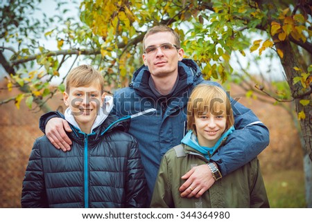 Family happiness - smiling child boy brothers walking outdoor