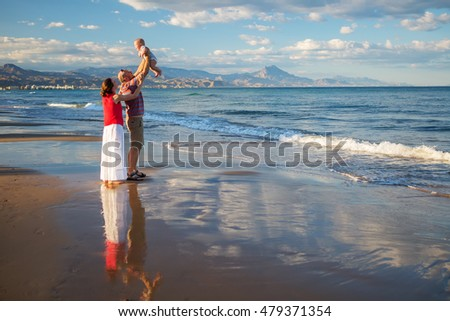 Family has fun at the seashore in summertime