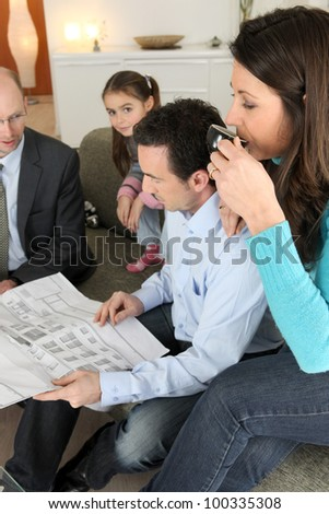 Family having a meeting with their architect - stock photo