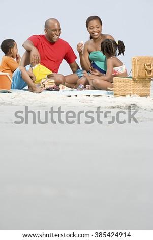 Family having a picnic - stock photo