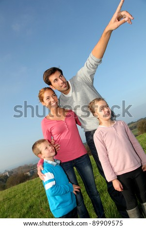 Family having a walk in countryside - stock photo