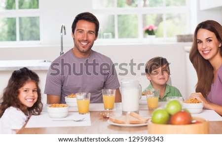 Family having breakfast in kitchen