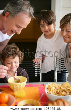 Family having breakfast together - stock photo