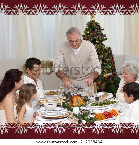 Family having Christmas dinner eating turkey against snowflake frame - stock photo