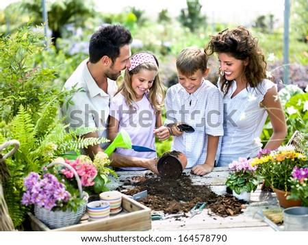 Family having fun gardening. - stock photo