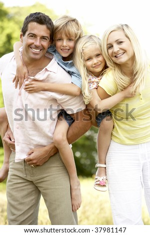 Family having fun in countryside - stock photo