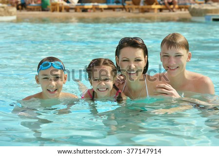 Family having fun in pool