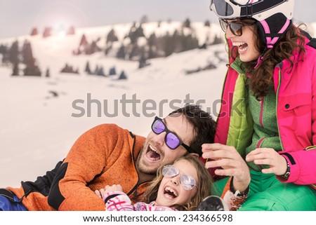 Family having fun in the snow - stock photo