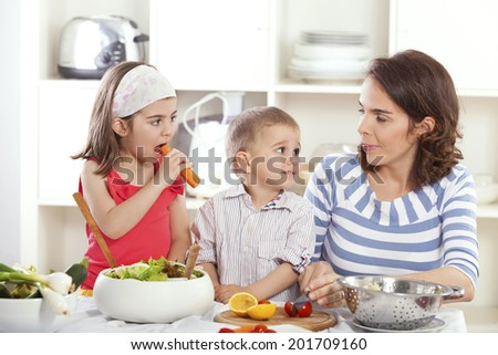 Family having fun making healthy food