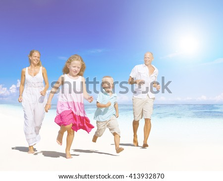 Family having fun on a beach.Young family enjoying their summer vacation. - stock photo