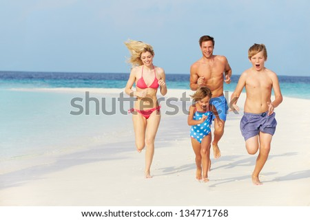 Family Having Fun On Beach Holiday - stock photo