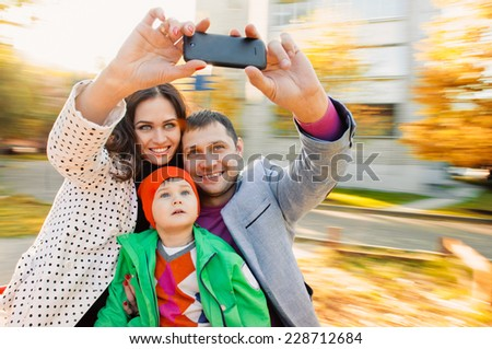 Family having fun on spinning roundabout. selfie Portrait. Naturally blur motion - stock photo