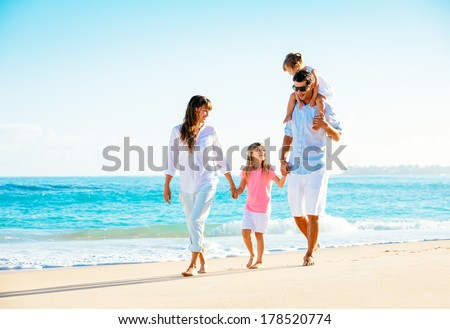 Family having fun on the beach