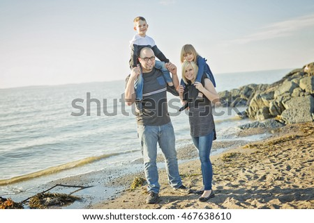 Family having great time ocean