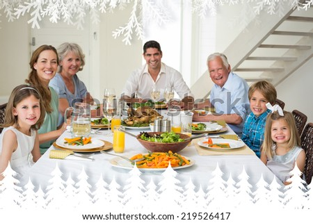 Family having meal together at dining table against fir tree forest and snowflakes