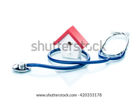 Family health concept, house model with stethoscope, on white background - stock photo