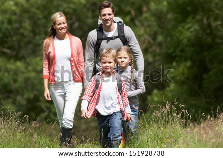Family Hiking In Countryside - stock photo