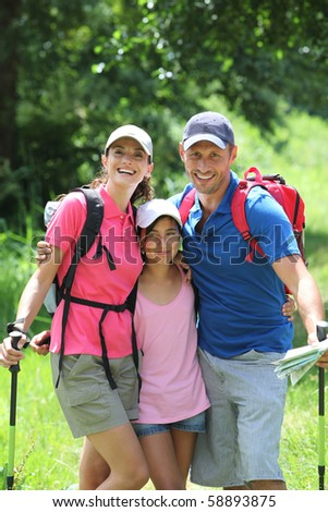 Family hiking in the countryside - stock photo