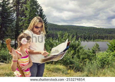 Family Hiking in the Mountains - stock photo