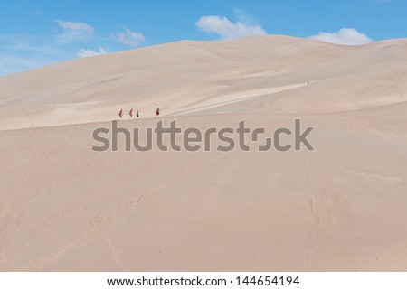 Family hiking the dunes, Great Sand Dune National Park, Sangre de Cristo Mountains near Mosca, Colorado