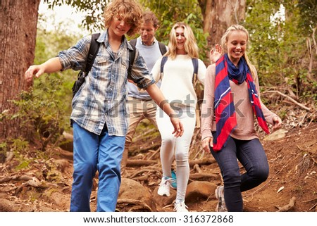 Family hiking through a forest, close up - stock photo