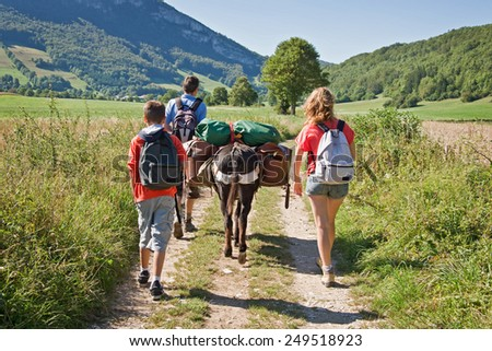 Family hiking with a pack donkey, Vercors, France