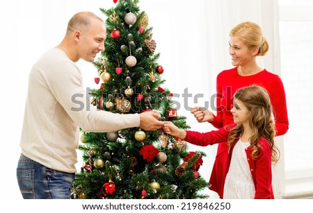 People Decorating For Christmas family xmas winter holidays people concept stock photo 332559449