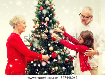 People Decorating For Christmas family decorating tree stock images, royalty-free images & vectors