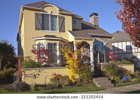 Family home and Autumn colors in Wilsonville Oregon. - stock photo