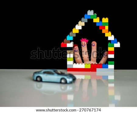 Family home and car concept with fingers - stock photo