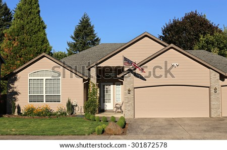Family home in suburban neighborhood - stock photo