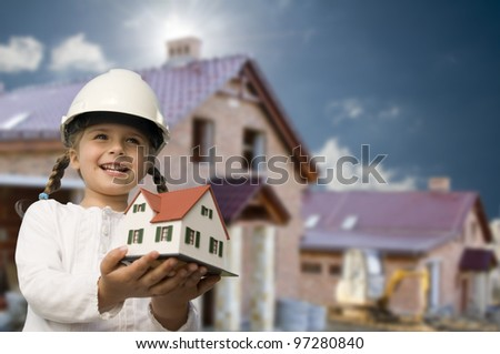 Family house concept - Outdoor portrait of lovely girl with house model - stock photo