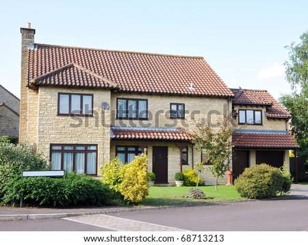 Family House on a Typical English Suburban Residential Estate - stock photo