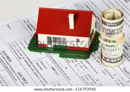 Family house with money and contract. Real estate background. - stock photo